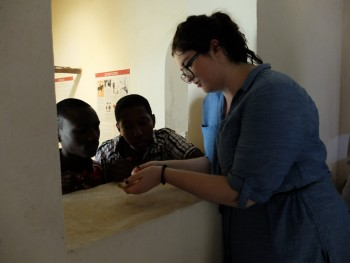 Members of the CONCH team pictured handling and looking at the objects from the two display cases. (Photo: Sara Perry).